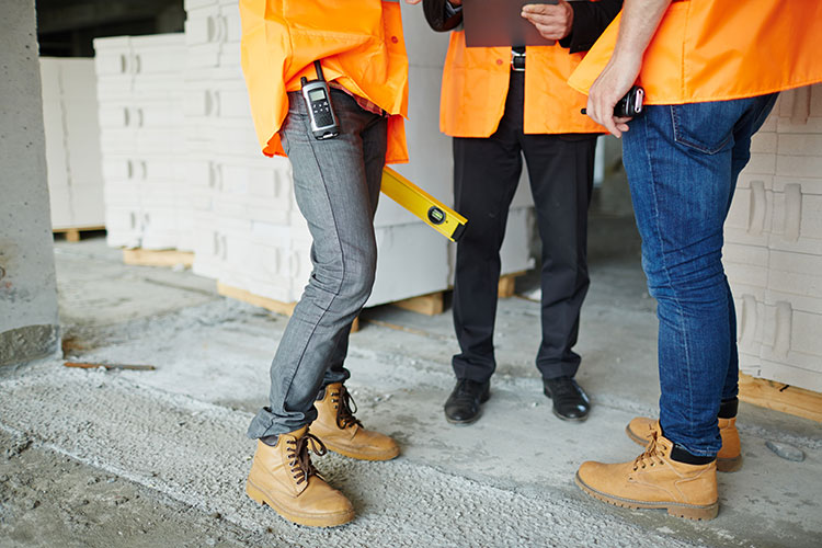 workers inspecting building site
