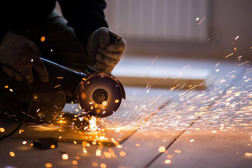 steel worker grinder sparks
