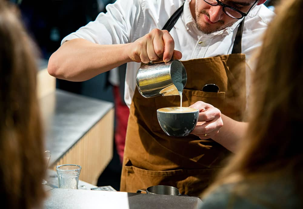 coffee barista pouring drink
