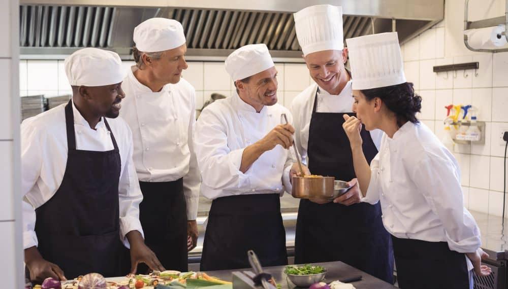 Chefs wearing their uniform.